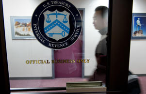 An IRS employee enters the office in the JFK Federal Building on March 24, 2011 in Boston, Massachusetts.