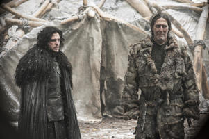 Jon Snow, portrayed by Kit Harington, left, appears with Mance Rayder, portrayed by  Ciaran Hinds in a scene from season four of Game of Thrones.