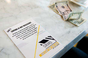 "A card presented with a bill Tuesday, Nov. 25, 2014 at Girard, a ""No-Tip"" restaurant in Philadelphia."