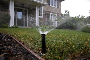 A sprinkler waters a lawn on April 7, 2015 in Walnut Creek, California.