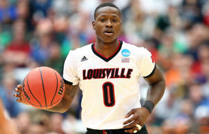 Terry Rozier of the Louisville Cardinals dribbles against the Michigan State Spartans in the first half of the game during the East Regional Final of the 2015 NCAA Men's Basketball Tournament at Carrier Dome on March 29, 2015 in Syracuse, New York.