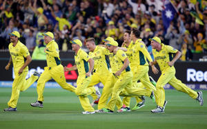 Australian players celebrate after they defeated New Zealand by seven wickets to win the 2015 Cricket World Cup final in Melbourne, Australia.