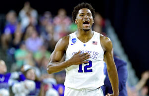 Duke Blue Devils forward Justise Winslow (12) reacts after making a three-point basket against the Utah Utes during the second half in the semifinals of the south regional of the 2015 NCAA Tournament at NRG Stadium on March 27, 2015, in Houston.