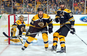 Tuukka Rask, left, Adam McQuaid, center, and Zdeno Chara of the Boston Bruins watch the play against the Anaheim Ducks at the TD Garden on March 28, 2015 in Boston, Massachusetts.