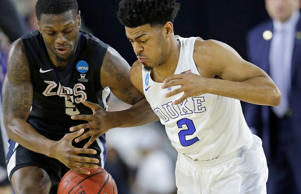 Gonzaga's Gary Bell Jr. (5) and Duke's Quinn Cook go after a loose ball during the first half of a college basketball regional final game in the NCAA Tournament Sunday, March 29, 2015, in Houston.