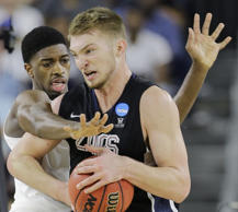 Gonzaga's Domantas Sabonis tries to drive past Duke's Matt Jones during the first half of a college basketball regional final game in the NCAA Tournament Sunday, March 29, 2015, in Houston. (AP Photo/David J. Phillip)