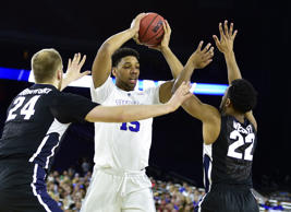 Mar 29, 2015; Houston, TX, USA; Duke Blue Devils center Jahlil Okafor (15) looks to pass away from Gonzaga Bulldogs guard Byron Wesley (22) and center Przemek Karnowski (24) during the first half in the finals of the south regional of the 2015 NCAA Tournament at Reliant Stadium. Mandatory Credit: Bob Donnan-USA TODAY Sports - RTR4VDYJ