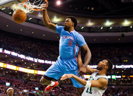 The Los Angeles Clippers' DeAndre Jordan dunks over Boston Celtics' Evan Turner in Boston on March 29.
