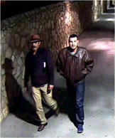 In this March 14, 2015 image taken from a surveillance camera provided by the FBI, a former Los Angeles police officer Henry Solis, right, and his father Victor Solis cross the border from El Paso, Texas, into Mexico. Victor Solis was arrested Thursday, March 26, at his home in Lancaster, Calif. He's charged with lying to FBI agents to help his son escape after the officer was charged with killing a man during an off-duty fight.