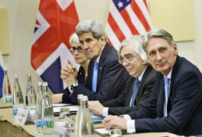 From left, US Under Secretary for Political Affairs Wendy Sherman, US Secretary of State John Kerry, US Secretary of Energy Ernest Moniz and British Foreign Secretary Philip Hammond wait for a meeting at the Beau Rivage Palace Hotelin Lausanne, Switzerland, Sunday March 28, 2015.