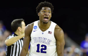 Duke Blue Devils forward Justise Winslow celebrates after making a three-point basket against the Gonzaga Bulldogs during the south regional of the NCAA Tournament March 29 in Houston. Duke won 66-52.