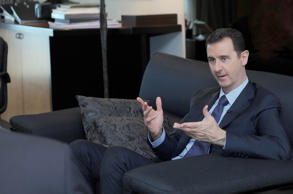 Syrian President Bashar al-Assad doing an interview with Russian newspaper Izvestia.