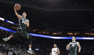 Michigan State's Travis Trice (20) in action against Virginia in Charlotte, North Carolina, March 22, 2015.