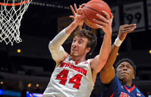 Wisconsin's Frank Kaminsky grabs a rebound in front of Arizona's Stanley Johnson during the first half of a college basketball regional final in the NCAA Tournament, Saturday, March 28, 2015, in Los Angeles.