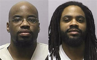 FILE - In this combination of 2013 file photos provided by the Kansas Department of Corrections, is Reginald D. Carr, left, and Jonathan D. Carr. The Kansas Attorney General announced Friday, Aug. 8, 2014 that he will ask the U.S. Supreme Court to reinstate death sentences for two brothers over the fatal shooting of four people in snow-covered soccer field. The Kansas Supreme Court, which overturned their death sentences in July, hasn't upheld a death sentence since the state enacted a new capital punishment law in 1994.