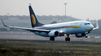 A Jet Airways passenger plane takes off from Sardar Vallabhbhai Patel International Airport in the western Indian city of Ahmedabad February 1, 2013. India's second biggest carrier Jet Airways, close to a tie-up with Abu Dhabi's Etihad Airways, swung to a quarterly profit of 850 million rupees on Friday on lower costs and rising fares in an under-serviced market. REUTERS/Amit Dave (INDIA - Tags: TRANSPORT BUSINESS)
