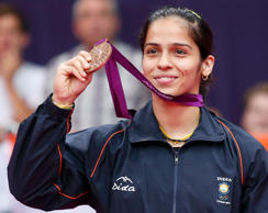 File: India's Saina Nehwal holds up her bronze medal at the women's singles badminton victory ceremony at the London 2012 Olympic Games at the Wembley Arena