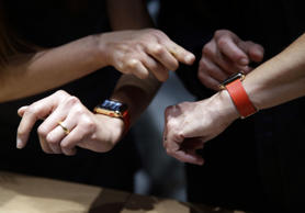 Members of the media and Apple guests get to review the new Apple Watch in the demo room after the Apple event on Monday, March 9, 2015, in San Francisco.