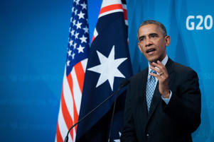 U.S. President Barack Obama gestures as he speaks during a news conference at the Group of 20 summit in Brisbane, Australia, Nov. 16, 2014.