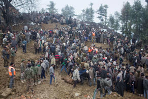 Villagers and officials search for bodies of victims following landslides due to heavy rainfall in the village of Laden some 45 km west of Srinagar on March 30.