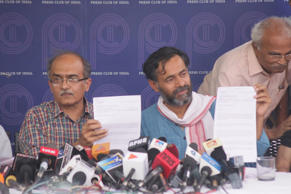 AAP leaders Prashant Bhushan and Yogendra Yadav address a press conference at the Press Club of India in New Delhi, on March 27