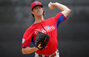Philadelphia Phillies starting pitcher Cole Hamels throws a warmup pitch before the start of an exhibition baseball game against the Toronto Blue Jays in Dunedin, Fla., Thursday, March 26, 2015.