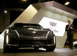 Cadillac President Johan de Nysschen delivers his keynote speech next to a 2016 CTS-V during press day for the Washington Auto Show in Washington January 22, 2015.