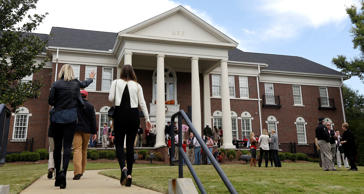 In this photo taken Oct. 26, 2013, guests and residents of the Delta Kappa Epsilon fraternity gather on the lawn prior to an NCAA college football game in Tuscaloosa, Ala. New fraternity and sorority houses with white columns, wide balconies and grand foyers line streets around the University of Alabama, and still more of the multimillion-dollar mansions are under construction. Alabama's Greek-letter social groups have been embroiled in controversy this fall over claims of racism and electioneering in a city school board race, but over the last decade they have undergone a $202 million building boom that's left the university with what one study determined is the nation's largest Greek system. Dave Martin/AP