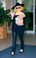 Lady Gaga arrives in Vienna with her dog 'Fozzi'