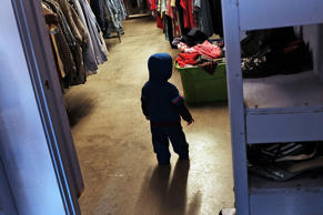 A child is viewed at a thrift store operated by Gonzales Christian Assistance Ministry, one of the few social services organizations in Gonzales assisting those in poverty on March 27, 2015 in Gonzales, Texas.