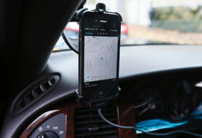 Transportation app Uber is seen on the iPhone of limousine driver in Beverly Hills, California, December 19, 2013.