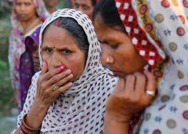 File: Indian women react as bodies of victims of a train accident are brought to a hospital at Bachhrawan village, in the northern Indian state of Uttar Pradesh, Friday, March 20, 2015.