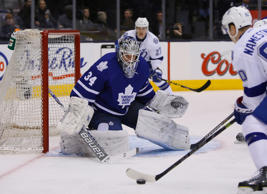 Toronto Maple Leafs goaltender James Reimer (34) makes a save on Tampa Bay Lightning forward Vladislav Namestnikov (90) during the first period at the Air Canada Centre.