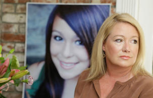 In this Thursday, May 23, 2013 file photo, Sheila Pott poses with a portrait of her daughter Audrie in Los Altos, Calif. Audrie Pott committed suicide in September 2012 after being sexually assaulted by three boys during a house party in Saratoga, Calif. Jury selection begins Monday, March 30, 2015, in a case where Audrie's parents allege that their daughter was driven to suicide by the assault by the three teen boys.