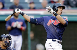 Cleveland Indians' Michael Brantley bats against the Minnesota Twins in the second game of a baseball doubleheader Thursday, Sept. 11, 2014, in Cleveland.