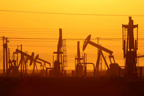 Pump jacks are seen at dawn in an oil field over the Monterey Shale formation where natural gas and oil are being extracted using hydraulic fracturing, or frackingon March 24, 2014 near Lost Hills, California.