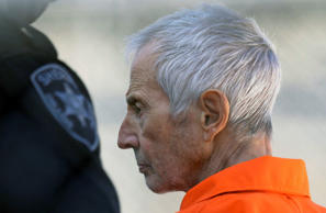 In this March 17, 2015, file photo, Robert Durst is escorted into Orleans Parish Prison after his arraignment in Orleans Parish Criminal District Court in New Orleans.