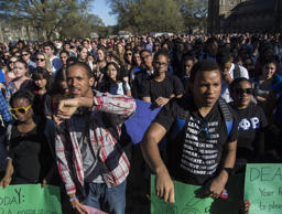 Duke students Ashton Pemberton, left, and Denzel Caldwell rally with hundreds during a university-wide forum Wednesday, April 1, 2015, outside Duke Chapel on Duke University's campus in Durham, N.C., after a noose was discovered hanging from a tree outside a student center on campus.