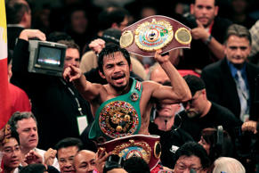 Manny Pacquiao, of the Philippines, holds the championship belt at the finish of his WBO welterweight boxing title fight against Miguel Cotto, of Puerto Rico, Saturday, Nov. 14, 2009 in Las Vegas. Pacquiao won the fight by TKO in the 12th round.