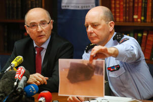 French prosecutor of Marseille, Brice Robin (L) and French Gendarmerie General David Galtier (R), who holds an image of the black box data flight recorder, attend a news conference in Marseille April 2, 2015. A Germanwings Airbus A320 crashed in the French Alps last week, killing the 150 people who were on board.
