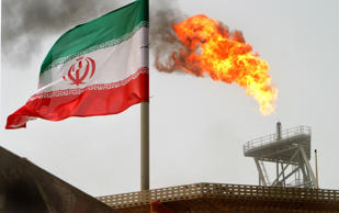 A 2005 photo of an Iranian flag flying at the Soroush oilfields in the Persian Gulf south of Tehran.