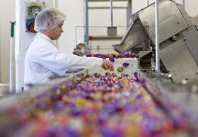 A worker inspects the eggs at the end of the production line for Cadbury Creme Eggs. The factory in Bournville, Britain makes approximately 1.5 million Creme Eggs every day.