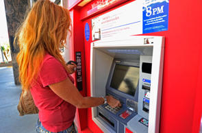 LOS ANGELES, CA - SEPTEMBER 29:  A customer uses a Bank of America ATM on September 29, 2011 in Los Angeles, California. Bank of America annouced its plans to start charging a $5 monthly fee for customers using their debit card for purchases starting early in 2012.  (Photo by Kevork Djansezian/Getty Images)