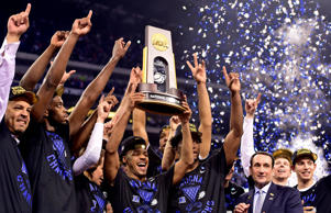 Duke Blue Devils guard Quinn Cook (middle) and teammates hoist the NCAA championship trophy after defeating the Wisconsin Badgers in the 2015 NCAA Men's Division I Championship game at Lucas Oil Stadium.