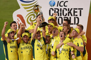 Australian captain Michael Clarke holds aloft the trophy with his teammates as they celebrate their seven wicket win over New Zealand in the Cricket World Cup final in Melbourne, Australia, Sunday, March 29, 2015