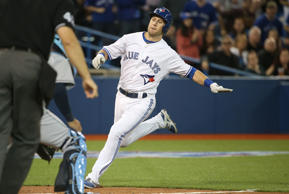Steve Tolleson of the Toronto Blue Jays runs home to score a run in the fifth inning during an MLB game against the Tampa Bay Rays on April 15, 2015 at Rogers Centre.