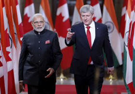 File: India's Prime Minister Narendra Modi (L) and Canada's Prime Minister Stephen Harper walk to a news conference on Parliament Hill in Ottawa April 15, 2015. Modi is making stops in Ottawa, Toronto and Vancouver during his visit to Canada.