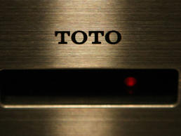 The Toto Ltd. logo is displayed on the sensor of a toilet bowl in Tokyo, Japan, on Thursday, April 10, 2008.