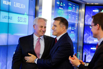 Virtu Financial CEO Douglas Cifu, left, and Executive Chairman Vincent Viola embrace during their company's IPO at the Nasdaq MarketSite, Thursday, April 16, 2015, in New York. The New York-based firm is one of the world's largest high-frequency trading companies.