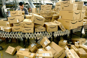 Daniel Brendoff sorts boxes before loading them onto trucks for shipping at Amazon.com's fulfillment Center in Fernley, Nevada on Tuesday, December 13, 2005. Between Thanksgiving and Christmas the Fernley Center will process approximately 2 million orders. Ken James/Bloomberg News